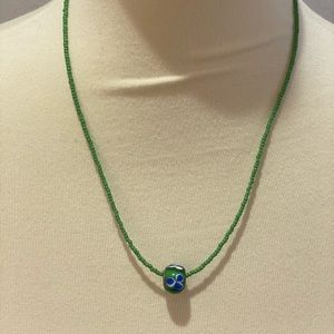 Hand crafted seed bead necklace with floral bead